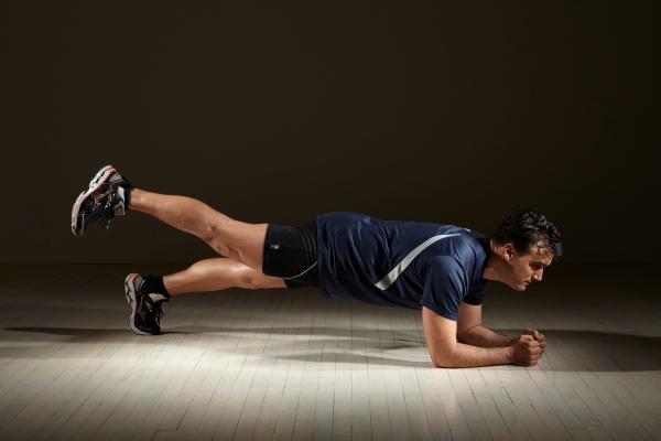 Michael Gonzalez-Wallace shows a core exercise-Plank Leg Up-